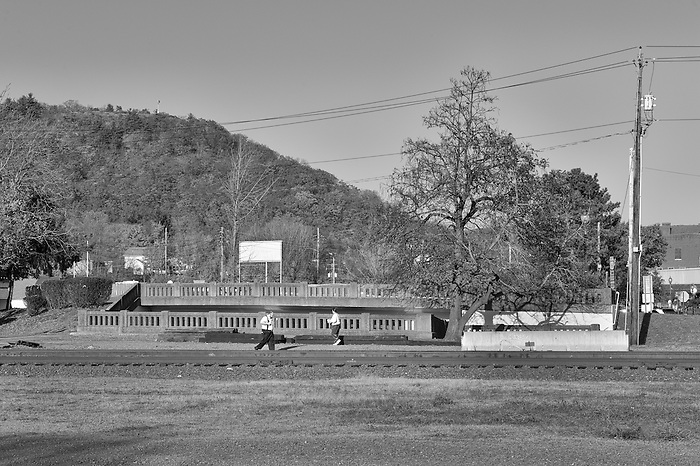 A man and a woman walking along the train tracks in Port Jervis New York