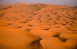 The winds of the Sahara create pattens in the brightly colored sand dunes, Morocco.