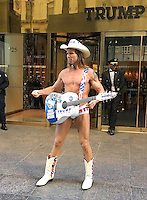 NEW YORK, NY - OCTOBER 31: Trump supporter The Naked Cowboy performs in front of the Trump Tower in New York, New York on October 31, 2016.  Photo Credit: Rainmaker Photo/MediaPunch