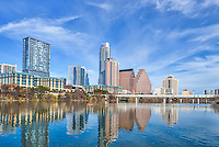 This slyline mage was taken from the hike and bike trail along Lady Bird Lake in downtown Austin on an excepitonal beautiful day with a very nice sky with wispy clouds over the city.  Took this image of downtown Austin with the latest editions to the skyline the Colorado Towers, which now blocks the iconic Frost building from this angle, but thats the way it is in this ever changing skyline. Today was a  good skies that  so when you do get one you need to take advanage quickly.  You can see the reflections in the water of the cityscape buildings along the shoreline with a lone canoe enjoying the day.