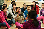 Middle school children participate in an icebreaker activity during a session of the Girls Values Program at the Boston Chinatown Neighborhood Center. Tufts Medical School students assist with the after school program, which helps Asian-American teens navigate the challenges of adolescence. (Alonso Nichols/Tufts University)