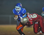 Lafayette High's Jamel Dennis (6) makes a tackle for loss vs. North Pontotoc's Caleb Mills (1) at William L. Buford Stadium in Oxford, Miss. on Thursday, October 27, 2011..