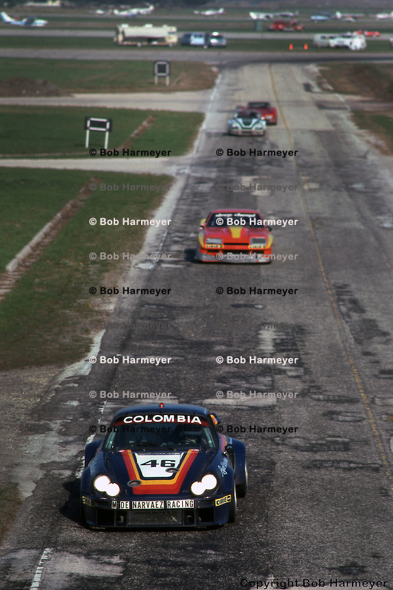 The Carrera RSR of  Maurico DeNarvaez and Albert Naon leads a group of cars during the 1977 race. This portion of the track no longer exists.