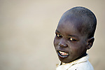 A displaced boy in Agok, a town in the contested Abyei region where tens of thousands of people fled in 2011 after an attack by soldiers and militias from the northern Republic of Sudan on most parts of Abyei. Although the 2005 Comprehensive Peace Agreement called for residents of Abyei--which sits on the border between Sudan and South Sudan--to hold a referendum on whether they wanted to align with the north or the newly independent South Sudan, the government in Khartoum and northern-backed Misseriya nomads, excluded from voting as they only live part of the year in Abyei, blocked the vote and attacked the majority Dinka Ngok population. The African Union has proposed a new peace plan, including a referendum to be held in October 2013, but it has been rejected by the Misseriya and Khartoum.