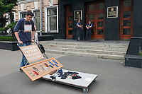 Moscow, Russia, 19/05/2012..Police guarding the Russian Federal Agency for Print and Mass Communication watch as several thousand artists and opposition activists demonstrate against Vladimir Putin by walking through Moscow transporting their artworks. The protest coincided with Museum Night, when Moscow's museums are open until midnight with special exhibitions and performances.