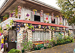 A home is decorated in buri for the evening's home decorations contest, part of the Bulihan Festival in Sampaloc, Quezon Province, the Philippines.  The contest grand prize was 15,000 Philippine pesos donated by the Buri Bag Project.  (15,000 pesos is more than two months' earnings for most skilled workers in the Philippines.)  (Sampaloc, Quezon Province, the Philippines)