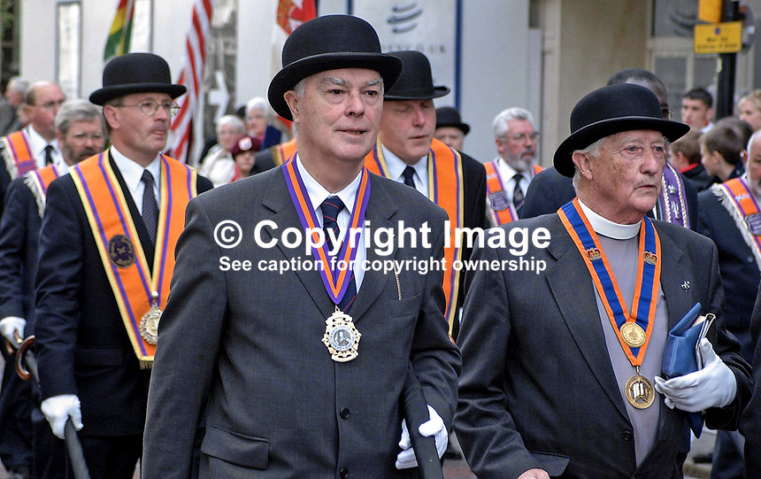 Rev Martin Smyth, Grand Master, Orange Order (centre), taking part in 2001 Twelfth of July Parade in Belfast., N Ireland, UK. Rev Smyth is also an MP at Westminster and was recently elected chairman of the Ulster Unionist Party at its AGM. Ref: 200107122696.<br /> <br /> Copyright Image from Victor Patterson, 54 Dorchester Park, <br /> Belfast, UK, BT9 6RJ<br /> <br /> t1: +44 28 9066 1296 (from Rep of Ireland 048 9066 1296)<br /> t2: +44 28 9002 2446 (from Rep of Ireland 048 9002 2446)<br /> m: +44 7802 353836<br /> <br /> e1: victorpatterson@me.com<br /> e2: victorpatterson@gmail.com<br /> www.victorpatterson.com<br /> <br /> Please see my Terms and Conditions of Use at www.victorpatterson.com. It is IMPORTANT that you familiarise yourself with them.<br /> <br /> Images used on the Internet must be visibly watermarked i.e. &copy; Victor Patterson<br /> within the body of the image and copyright metadata must not be deleted. Images <br /> used on the Internet have a size restriction of 4kbs and will be chargeable at current<br />  NUJ rates unless agreed otherwise.<br /> <br /> This image is only available for the use of the download recipient i.e. television station, newspaper, magazine, book publisher, etc, and must not be passed on to any third <br /> party. It is also downloaded on condition that each and every usage is notified within 7 days to victorpatterson@me.com<br /> <br /> The right of Victor Patterson to be identified as the author is asserted in accordance with The Copyright Designs And Patents Act (1988).