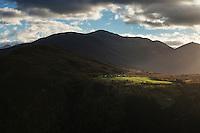 Ray on light on mountain farm in autumn, near Eidsdal, Møre og Romsdal, Norway