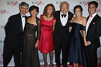 """(L-R) Gary Lauder, Laura Lauder, Judy Glickman Lauder, Leonard Lauder, Eliana Lauder, and Joshua Lauder attend The Breast Cancer Research Foundation """"Super Nova"""" Hot Pink Party on May 12, 2017 at the Park Avenue Armory in New York City."""