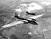 Tactical Air Command's B-57 bomber (black plane in this formation) glides into position on the wing of this Strategic Air Command sister ship, the wider-winged RB-57D. The RB-57D was built strictly as a high altitude reconnaissance platform..Credit: U.S. Air Force via CNP