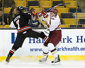 Anthony Bitetto (Northeastern - 7), Paul Carey (BC - 22) - The Boston College Eagles defeated the Northeastern University Huskies 5-4 in their Hockey East Semi-Final on Friday, March 18, 2011, at TD Garden in Boston, Massachusetts.