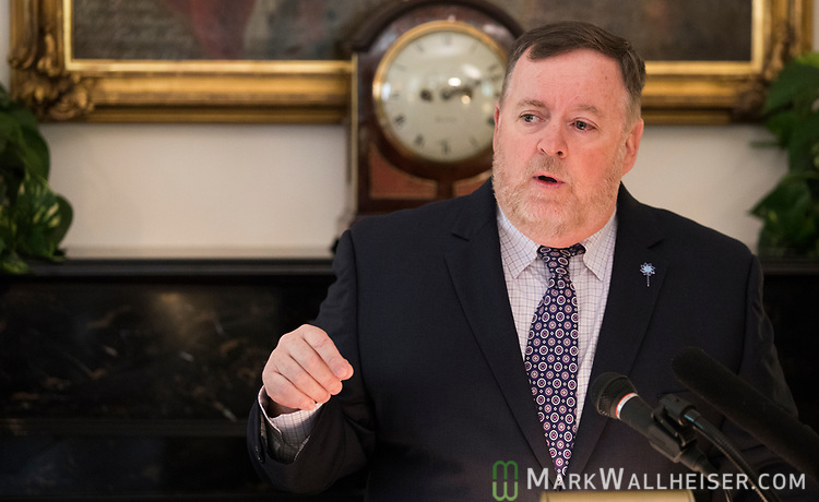 """Mike Carroll, Secretary of Department of Children and Families, speaks during a press conference to launch Prevent Child Abuse with Florida's annual """"Pinwheels for Prevention"""" campaign at the Florida Governor's Mansion."""