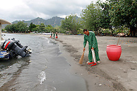 Workers sweep a patch of a beach in front of a hotel in Pemuteran on Bali's North coast. The beaches are full of plastic and other rubbish washed up from the ocean, especially in the rainy season. Some places have a system for cleaning the beaches but outside tourist areas the environmental awareness is very low.