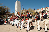 In this photograph provided by VisitSanAntonio.com via AP Images, historical re-enactors, dressed as Mexican soldados, observe the 175th anniversary of the Battle of the Alamo by marching past the Alamo Cenotaph monument that commemorates the heroes of the battle, Saturday, March 5, 2011, at Alamo Plaza in San Antonio. Events are being staged throughout 2011 in honor of the battle. (Darren Abate/VisitSanAntonio.com via AP Images)
