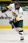 5 January 2007: University of Vermont forward Peter Lenes from Shelburne, VT, in action against the University of New Hampshire Wildcats at Gutterson Fieldhouse in Burlington, Vermont. The UNH Wildcats defeated the UVM Catamounts 7-1 in front of a record setting 48th consecutive sellout at &quot;the Gut&quot;...Mandatory Photo Credit: Ed Wolfstein Photo.<br />