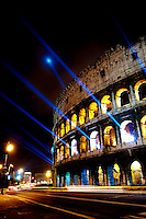 The Colosseum illuminated with blue laser lights, makes a spectacular show, Rome, Italy