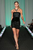 Model walks runway in an outfit by Morgan Julia Bisignano, for the Syracuse University, College of Visual and Peforming Arts 2011 Fashion Show Gala.