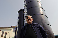"CEO Masanori Honda stands in from of a launching tube for a ""yonshakudama"" firework in front of Katakai Fireworks Co., Ltd, Katakai, Japan, April 7, 2009. The company makes the world's largest firework, a 120cm round shell called a ""yonshakudama""."