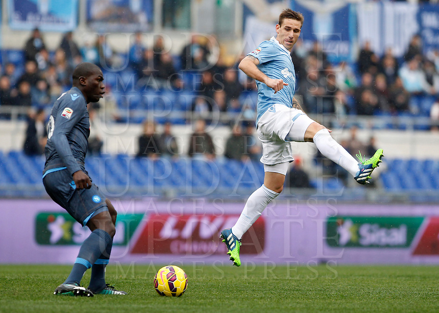 Calcio, Serie A: Lazio vs Napoli. Roma, stadio Olimpico, 18 gennaio 2015.<br /> Napoli&rsquo;s Kalidou Koulibaly, left, is challenged by Lazio&rsquo;s Lucas Biglia during the Italian Serie A football match between Lazio and Napoli at Rome's Olympic stadium, 18 January 2015.<br /> UPDATE IMAGES PRESS/Isabella Bonotto