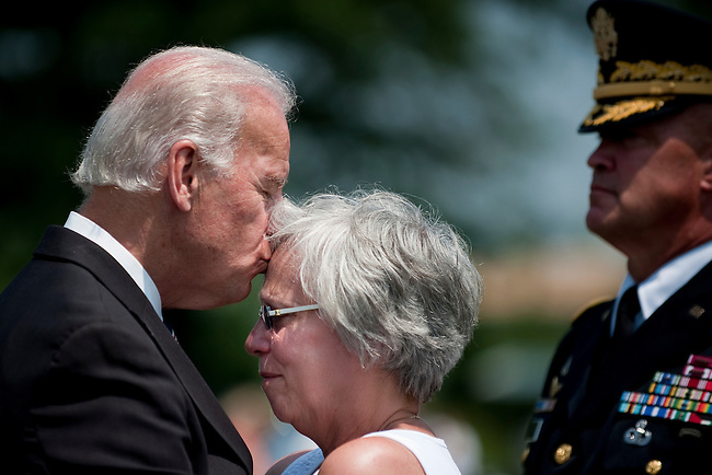 May 31, 2010 - Washington, District of Columbia, U.S., -  Vice President Joe Biden kisses the forehead of Susan Van Aalten during a visit to Section 60 of Arlington National Cemetery on Memorial Day. Aalten 's son, Sergeant Alexander Van Aalten, 21, of Monterey, Tennessee, was killed April 20, 2007, in Sangin, Afghanistan, of wounds suffered when a land mine detonated near his unit during combat operations. He was assigned to the 1st Battalion, 508th Parachute Infantry Regiment, 4th Brigade Combat Team, 82nd Airborne Division, Fort Bragg, North Carolina. (Credit Image: &copy; Pete Marovich/ZUMA Press)