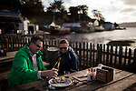 Bill Alexander, left, and Anna Patterson, right, enjoy fresh oysters at Hog Island Oyster Company in Marshall, Calif., December 12, 2012.