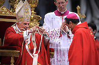 Pope Benedict XVI leads a solemn mass at St Peter's basilica to celebrate the feast of Saint Peter and Saint Paul on June 29, 2009 at The Vatican. Pope Benedict XVI placed palliums around the necks of 34 new archishops, symbol of their authority and responsability