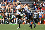 09 September 2012: Duke's Kaitlyn Kerr (left) and Katie Trees (right) challenge for the ball with Marquete's Ally Miller (3). The Duke University Blue Devils defeated the Marquette University Golden Eagles 5-2 at Koskinen Stadium in Durham, North Carolina in a 2012 NCAA Division I Women's Soccer game.