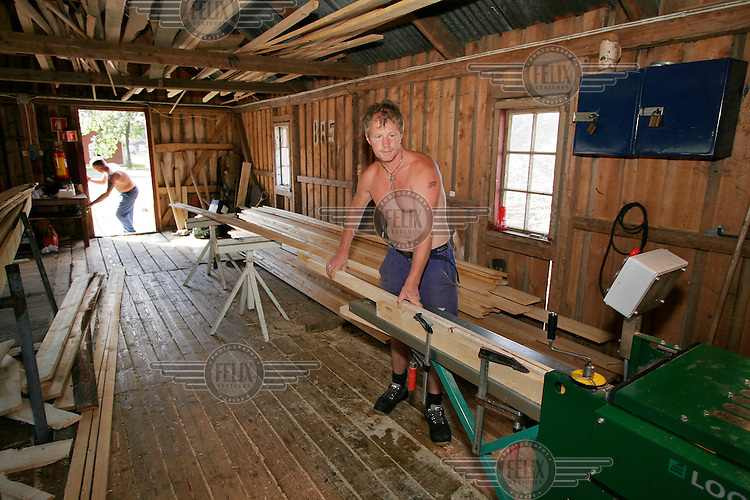 Prisoner making plank in a workshop...Bastøy Prison/Horten/Norway. ©Fredrik Naumann/Felix Features