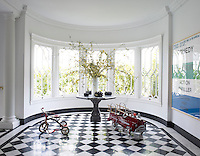 The table in the entry hall was designed by Michael Taylor for Trevor's mother, and the windows are original to the Georgian house; the artwork is by Keith Tyson