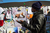 A man prays for Nelson Mandela outside the Medic-Clinic Heart hospital where the former president is being treated, in Pretoria, South Africa.