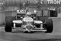 DETROIT, MI - JUNE 22: Nigel Mansell of Great Britain drives the Williams FW11/Honda RA166E during the Detroit Grand Prix FIA Formula One World Championship race on the Detroit Street Circuit in Detroit, Michigan, on June 22, 1986..