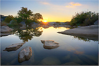 Over a quiet pool at Pedernales Falls State Park, the sun breaks over the horizon. Nothing but the fish and me in this little sanctuary in the Texas Hill Country this morning.