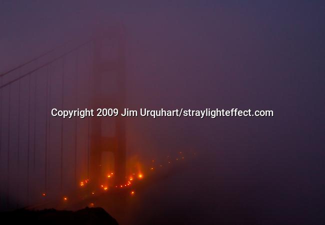 The Golden Gate Bridge shrouded in fog in San Francisco, California. Jim Urquhart/straylighteffect.com 7/26/09