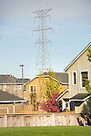 Suburban neighborhood and High tension power tower.