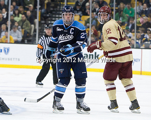 Will O'Neill (Maine - 27), Kevin Hayes (BC - 12) - The Boston College Eagles defeated the University of Maine Black Bears 4-1 to win the 2012 Hockey East championship on Saturday, March 17, 2012, at TD Garden in Boston, Massachusetts.