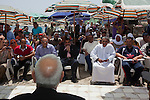 Egyptian Islamist presidential candidate Abdul Moneim Aboul Fotouh speaks with a group of fisherman during a campaign stop May 1, 2012 in the town of Abu Qir just outside Alexandria, Egypt. Aboul Fotouh listened to the complaints and issues that are important to fisherman and spoke briefly to the crowd that had assembled there.