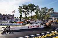 Jun 10, 2016; Englishtown, NJ, USA; NHRA top fuel driver Richie Crampton (near) races alongside J.R. Todd during qualifying for the Summernationals at Old Bridge Township Raceway Park. Mandatory Credit: Mark J. Rebilas-USA TODAY Sports