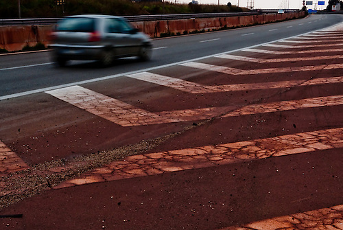 Taranto Italy 2010<br /> Ring road between Tamburi quarter and ILVA steelworks. The iron dust gives a red color to the Tamburi quarter and to all the places nearby the Industry.