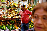 Puerto Ricans shop for produce at an indoor market, in San Juan, Puerto Rico, on Friday, November 14, 2008.