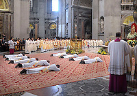 new priests Pope Benedict XVI during an ordination mass at St Peter's basilica at the Vatican on April 29, 2012