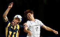 Japan's Sanfrecce Hiroshima Hyungjin Park (R) and Central Coast Mariners Matthew Simon during their AFC Champions League match in Gosford, near Sydney, March 11, 2014. VIEWPRESS/Daniel Munoz EDITORIAL USE ONLY