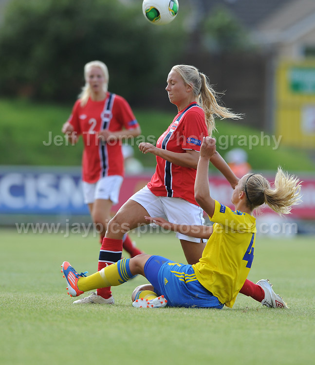 Lisa Naalsund of Norway battles with Amanda Hallesjo of Sweden during the UEFA Womens U19 Championships at Stebonheath park Sunday 25th August 2013. All images are the copyright of Jeff Thomas Photography-www.jaypics.photoshelter.com-07837 386244-Any use of images must be authorised by the copyright owner.