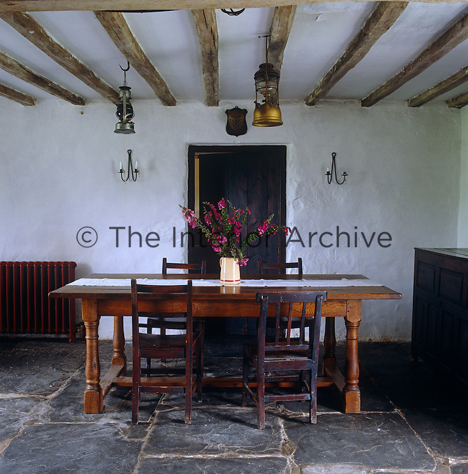 The farmhouse still has no electricity so the dining area is lit by candles oil lanterns
