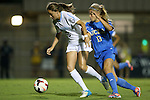 06 September 2013: North Carolina's Megan Brigman (3) and UCLA's Rosie White (NZL) (13). The University of North Carolina Tar Heels played the University of California Los Angeles Bruins at Koskinen Stadium in Durham, NC in a 2013 NCAA Division I Women's Soccer match. UNC won the game 1-0.
