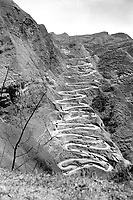 U.S. Convoy which operates between Chen-Yi and Kweiyang, China, is ascending the famous twenty-one curves at Annan, China.  March 26, 1945.  Pfc. John F. Albert.  (Army)<br /> NARA FILE #:  111-SC-208807<br /> WAR &amp; CONFLICT BOOK #:  1158