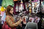 (Eng) Tokyo, March 8, 2010 - In the &quot;Don Quichote&quot; supermarket in the Shibuya district. Rika, 15, checking out a Tokyo Girl Cover outfit. This Japanese brand's concept is quite simple: the clothes are imitations, made in China, of outfits whose pictures were published in Japanese fashion magazines. The outfit is sold 3 000 Yens (23 Euros).<br /> <br /> (Fr)Tokyo, 8 mars 2010 - Dans le supermarch&eacute; &quot;Don Quichote&quot; du quartier de Shibuya, Rika, 15 ans, jette un coup d'oeil &agrave; une tenue de la Tokyo Girl Cover. Cette marque japonaise imite les tenues des magazines de mode japonais, les fait fabriquer en Chine et les revend sous forme de panoplies pour une somme modique (3000 yens, soit  23 euros).