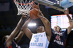 16 November 2014: North Carolina's Kennedy Meeks (3) is fouled by Robert Morris's Stephan Bennett (45). The University of North Carolina Tar Heels played the Robert Morris University Colonials in an NCAA Division I Men's basketball game at the Dean E. Smith Center in Chapel Hill, North Carolina. UNC won the game 103-59.