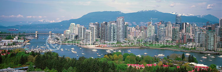 "City of Vancouver Skyline and Downtown at Yaletown and ""False Creek"", British Columbia, Canada, in Spring.  The Granville Street Bridge and the Burrard Street Bridge are in the left midground, and the North Shore Mountains (Coast Mountains) rise above the City. - Panoramic View"