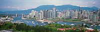 """City of Vancouver Skyline and Downtown at Yaletown and """"False Creek"""", British Columbia, Canada, in Spring.  The Granville Street Bridge and the Burrard Street Bridge are in the left midground, and the North Shore Mountains (Coast Mountains) rise above the City. - Panoramic View"""