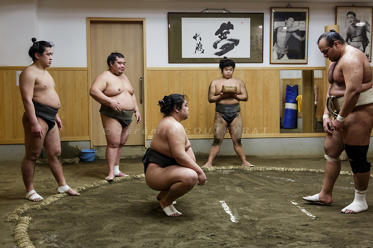 Tokyo, February 5 2015 - Training at Otake stable in the Taito area. Young low-ranking wrestlers (left) trying to beat Osunaarashi Kintaro (right), wrestler of the top division.
